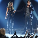 Angie performs with Adam Lambert