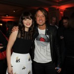 Keith Urban poses with Zooey Deschanel at FOX